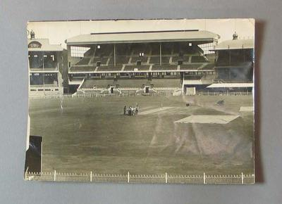 Black and white photograph of groundsmen on the pitch, MCG, taken from the stands, March 1929.