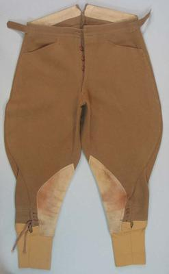Brown felt jodhpurs, 2 pockets, suede knee patches, elastic cuffs, part of informal riding suit.