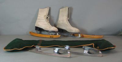 Pair of white ice skates worn by Australian figure skater Betty Marinda Cornwell and skate accessories