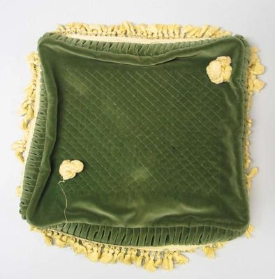 Green velvet cushion most likely used for medal presentations at the 1956 Olympic Games