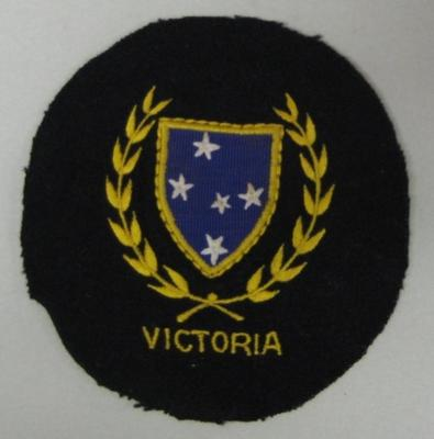 Circular navy blue badge - Victorian Baseball Association - Alan Connolly collection