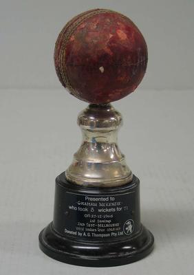 Cricket ball on stand presented to Graham McKenzie, 1968