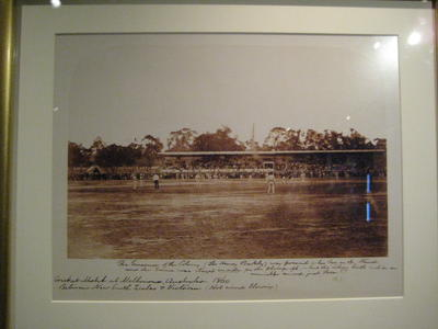 Framed and mounted reproduction of an albumen silver photograph of Intercolonial Cricket Match at Melbourne, 1860,  New South Wales v Victoria, photographer Barnett Johnstone.