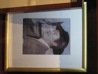 Framed, mounted black and white reproduction photo of USA comedian Bob Hope at the MCG