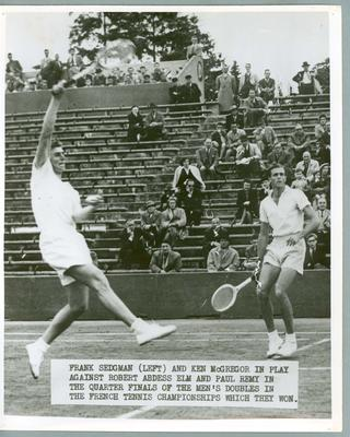 Black and white press photograph of tennis players Frank Sedgman and Ken McGregor during the quarter finals of the Men's Doubles in the French Tennis Championships, c.1951