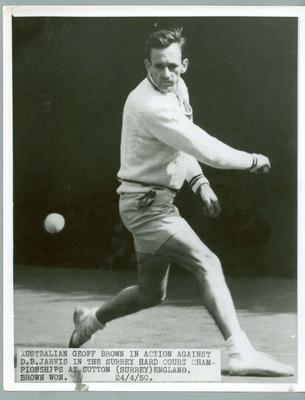 Black and white press photograph of tennis player Geoff Brown during the Surrey Hard Court Championships, 1950.