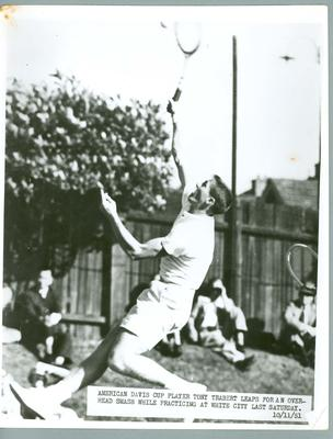 Black and white press photograph of American tennis player Tony Trabert at practice for the Davis Cup, 1951.