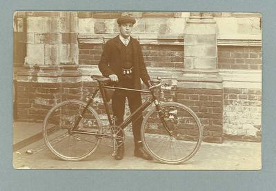 Postcard, image of unknown man with bicycle