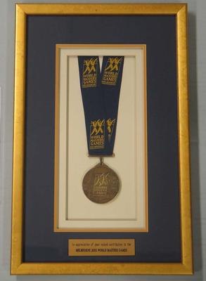 Framed World Masters medal presented to Minister for Sport Justin Madden, 2002