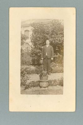 Postcard, image of unknown man in garden