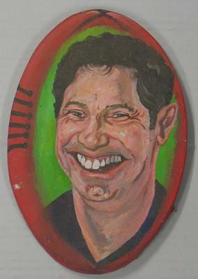 Oval shaped painting of Carlton Football Club player Justin Madden, painted by Spook, June 1996