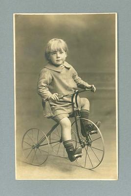 Postcard, image of unknown boy on tricycle