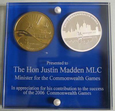 Two commemorative Commonwealth Games five dollar ($5.00) coins mounted in acrylic, presented to Minister for the Commonwealth Games, Justin Madden, 2006