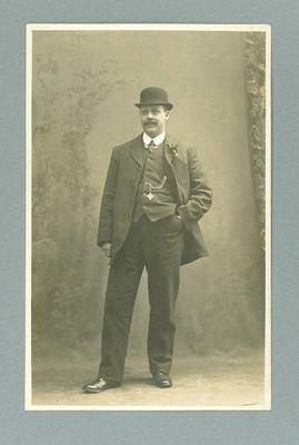 Postcard, image of unknown man wearing suit and hat