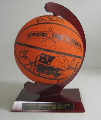 Basketball on stand signed by members of the North Melbourne Giants, 1994 NBL Champions.; Sporting equipment; N2011.17.4