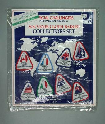 Display Card containing 8 Cloth badges re 1987 America's Cup Challengers