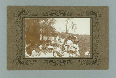 Postcard, image of unknown group in country setting