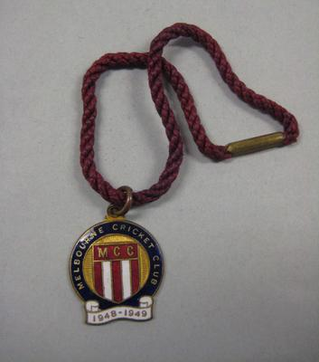 Melbourne Cricket Club membership medallion, 1948/49, with maroon lanyard