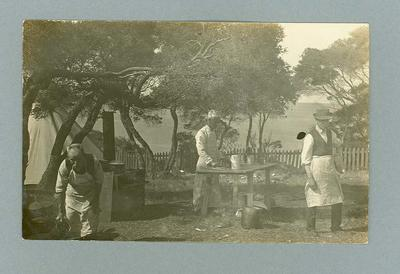 Postcard, image of three unknown men outdoors