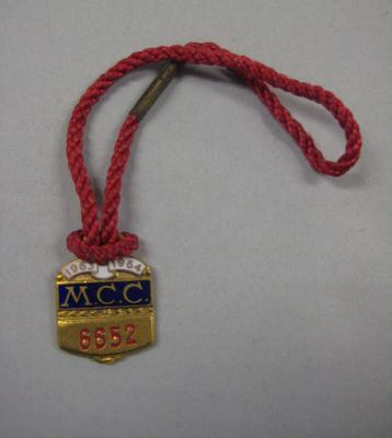 Melbourne Cricket Club membership medallion, 1963/64, with red lanyard