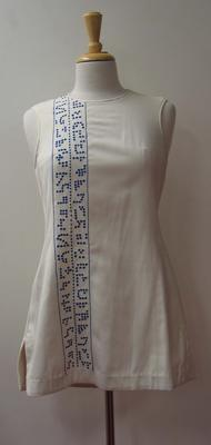 Tennis dress with navy blue stitched detail worn by Judy Dalton