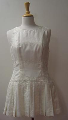 Tennis dress with white flower detail worn by Judy Dalton