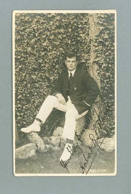 Postcard, image of unknown man wearing blazer and white pants