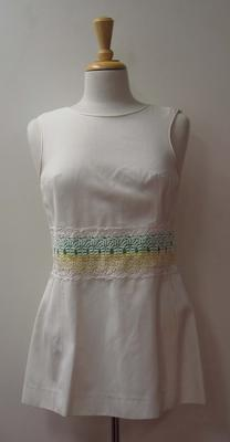 Tinling tennis dress with green and yellow ribbon and white lace detail worn by Judy Dalton