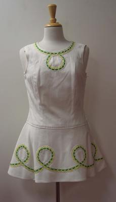 Tinling tennis dress with looping design in green and yellow ribbon and white lace detail worn by Judy Dalton