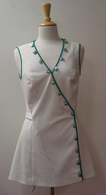 Tinling tennis dress with green piping and button detail worn by Judy Dalton