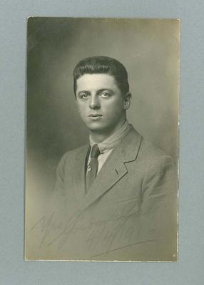 Postcard, image of unknown man wearing suit