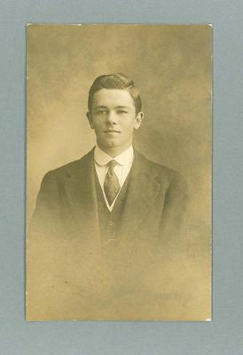 Postcard, image of unknown man in suit