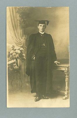 Postcard, image of unknown man wearing academic dress