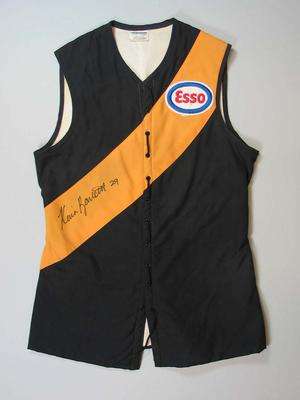 Signed Richmond jerkin worn by Kevin Bartlett is his 403rd (and final) VFL match, 1983