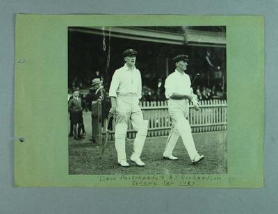 Photograph of Dave Pritchard and Arthur Richardson walking onto cricket field, Jan 1927