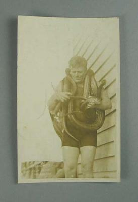 Postcard, image of Sid Rohu with snakes at the St Kilda Baths