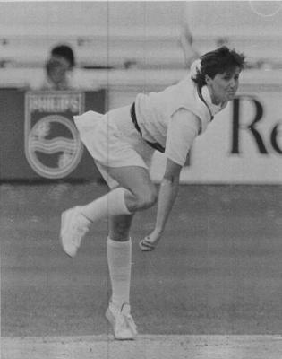 Copy negative depicting female cricketer, c1988