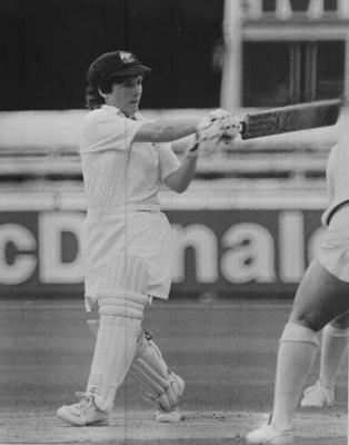 Copy negative depicting female cricket player, c1988