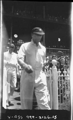 Negative, depicts cricketers walking on to a cricket ground c1932