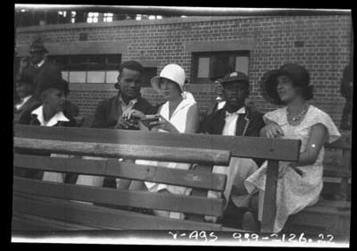 Negative, depicts West Indian cricketers & friends seated in a grandstand c1932