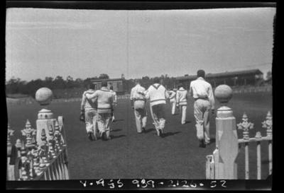 Negative, depicts a team of cricketers walking on to a ground c1932