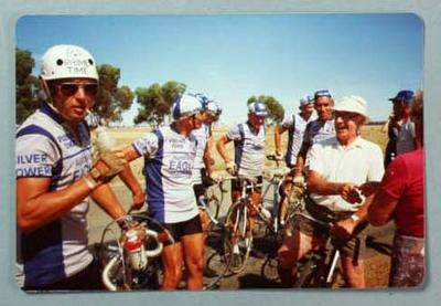 Colour photograph of Eric Gibaud and cyclists, 1980s