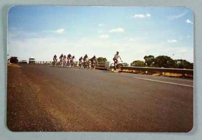 Colour photograph of Eric Gibaud and cyclists.