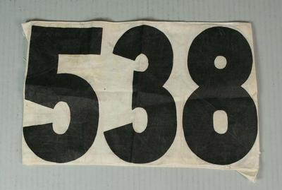 Competitor's number worn by Nancy Jane Borwick, Melbourne Olympic Games, 1956