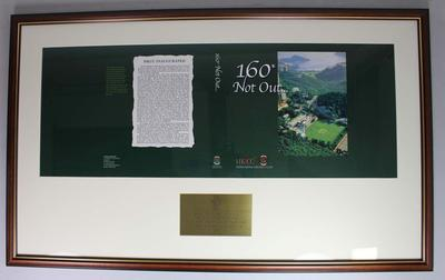 Framed cover of Hong Kong Cricket Club's 160th Anniversary commemorative book