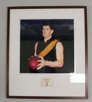 Framed reproduction photograph of Pat Guinane, Richmond F.C. from Scanlens 1966 Flag Series football cards