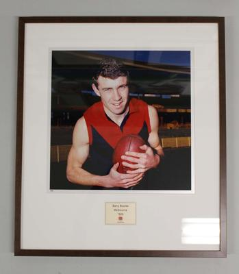 Framed reproduction photograph of  Barry Bourke, Melbourne  F.C. from Scanlens 1966 Flag Series football cards