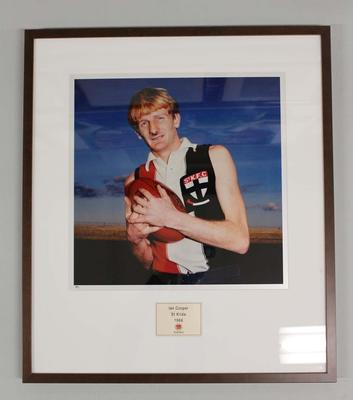 Framed reproduction photograph of Ian Cooper, St. Kilda F.C. from Scanlens 1966 Flag Series football cards