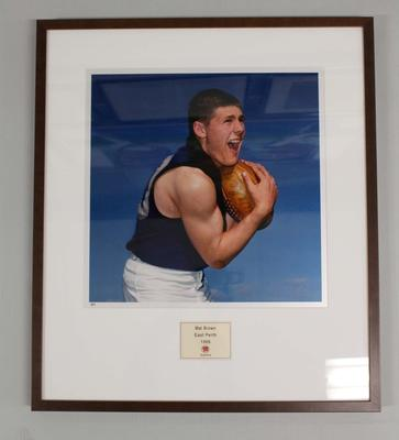 Framed reproduction photograph of Mal Brown, East Perth  F.C. from Scanlens 1966 Flag Series football cards