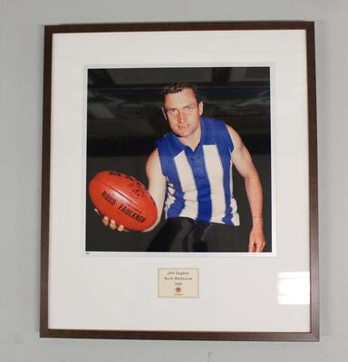 Framed reproduction photograph of John Dugdale, North Melbourne  F.C. from Scanlens 1966 Flag Series football cards